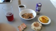 Bowl of oats, blue berries, and strawberries. Silk Soy Milk, English Muffin w/Orange marmalade, sliced oranges, black coffee, and cranberry juice.