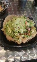 Fried bowl with brown rice, black beans, corn, guacamole, pico de gallo, and lettuce at Little Boomer's Burrito Bar.