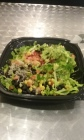 Vegan rice bowl with black and pinto beans, corn, pico de gallo, lettuce, and guacamole at Little Boomer's Burrito Bar!